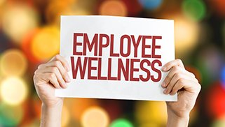 Employee Benefits placard with bokeh background