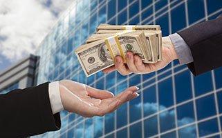 Handing Cash w Corp Bldg-web