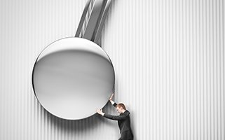 businessman pushing the pendulum